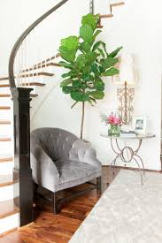 foyer accent table curved staircase nook with chair and table transitional