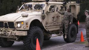 tactical vehicles marines drive through heavy snowfall harsh winds to obtain