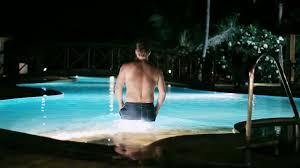 man swiming in a pool at night swimming pool stock video footage