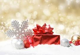 glittery golden christmas background with decoration in snow photo