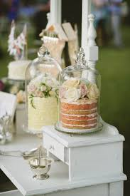 wedding dessert table displays adore the cakes in the cake stands wedding food and beverage