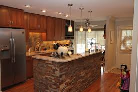 open kitchen with cultured stone backsplash u0026 accent wall cambria