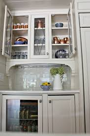 glass cabinets in white kitchen how to style beautiful and functional glass kitchen cabinets