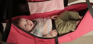 portable diaper changing table baby change n go is a portable changing table that hangs on a door