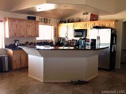 how to make a kitchen island using cabinets before and after diy kitchen island makeover addicted 2 diy