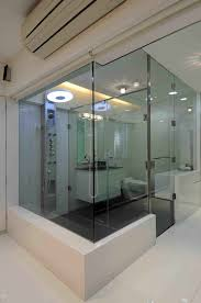 luxury master bathroom with glass doors designed by sonali shah
