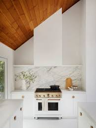 kitchen backsplash with white cabinets and white countertops these backsplash ideas bring out the best of white kitchen