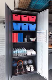 best 25 garage gym ideas on pinterest home gym garage home open cabinet with baskets binders bottled water towels and excercise balls