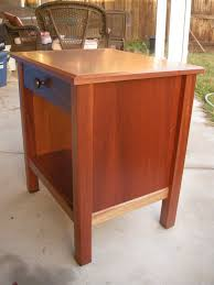 african mahogany nightstand with pomelle figured top by
