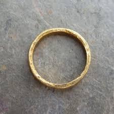 artisan wedding rings gold primitive 24k wedding ring artisan hammered flat