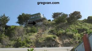 homes built into hillside concrete over slope soil erosion tips homes on hillsides youtube