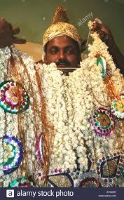 muslim and groom muslim groom being dressed for his wedding tamil nadu india