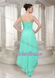 low mint green bridesmaid gown with spaghetti straps beaded