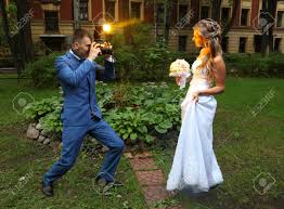 professional wedding photography professional wedding photographer takes a picture of the