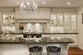 charming white kitchen island with elegant crystal chandelier for