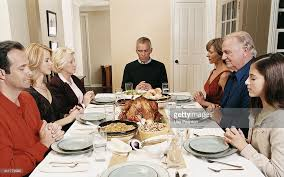 family saying grace at a thanksgiving meal stock photo getty images