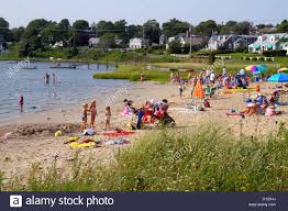 massachusetts cape cod chatham oyster pond beach sunbathers family