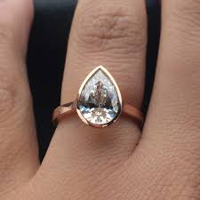 non traditional engagement rings the perfect rose gold pear shaped diamond bezel engagement ring