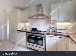 cream modern kitchen contemprary cream colored modern kitchen range stock photo