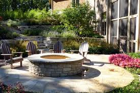 raised stone fire pit surrounded by flagstone van zelst