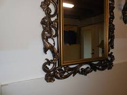 alices room set of wooden sconces and mirror no longer available