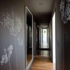 dark charcoal gray hallway like the dark paint with white trim