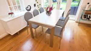 large extending dining table matt white extending dining table brushed metal legs seats 8