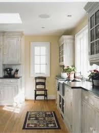 sunshiny white washed kitchen cabinets