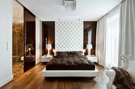 bedroom wooden bed frame on the wooden floor inside modern wall