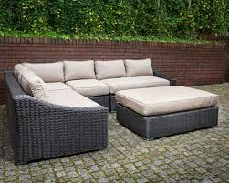 toja patio furniture tuscan sectional set red brick wall
