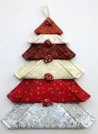 santa ornament made from a log cabin block quilting digest