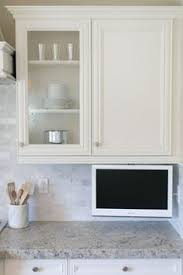 under cabinet mount tv for kitchen lcd tv under cabinet mount ideal for the kitchen it elegantly