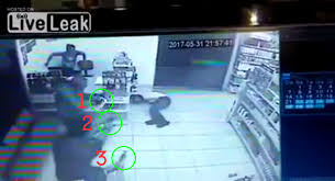 video suspect draws gun gets shot in store where everyone was armed