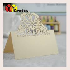 folded table place cards laser cut light gold folded paper delicate wedding party table place