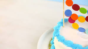 simple white birthday cake with cake garland stock footage video