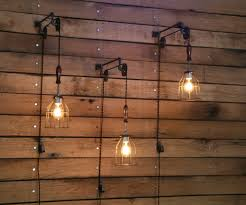 Wall Mounted Lighting Fixtures Pulley Wall Mount With Industrial Cage Light And Wooden Handle
