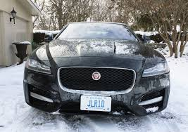 jaguar front taking a big cat out to play in the snow wheels ca