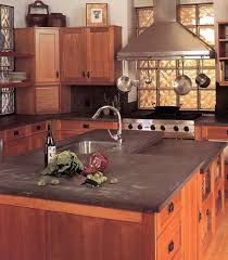 granite countertop dark kitchen cabinets with light wood floors