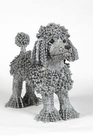 unchained i create dog sculptures from recycled bicycle chains