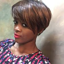pic of black women side swept bangs and bun hairstyle 50 short hairstyles for black women stayglam