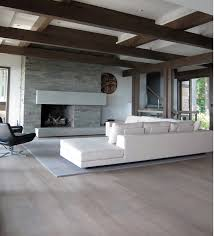 white washed wood floors with white walls and ceiling home