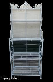 etagere in ferro battuto etagere in ferro battuto di color bianco con piani ribaltabili