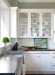 modern farmhouse kitchen glass front cabinets walnut counter