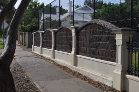 Willow Fencing Lowes by Charcoal Willow Front Yard Screening Fence Between Ivory Concrete