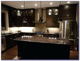 Dark Kitchen Cabinets Light Countertops Dark Kitchen Cabinets With Glass Backsplash Light Countertops