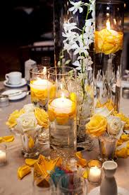 Wedding Centerpieces Floating Candles And Flowers by Gorgeous Tall Cylinder Vase With Floating Candle Makes A Big Wow