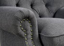 traditional gray fabric sofa with nailhead trim