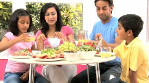 ethnic family healthy lunch together royalty free