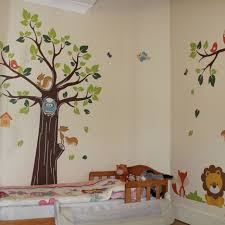 baby nursery toddler kids bedroom decoration with brown wooden bed