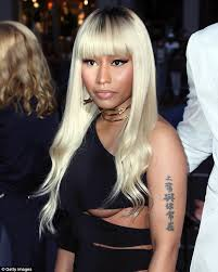 cutting hair so it curves under nicki minaj shows underboob in cut out frock at barbershop the